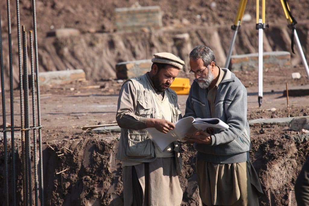 The Borlaug site manager, rt , consults with the Safi site manager during the building of the Nagarhar University Agriculture building project site ( sponsored by HG Buffet foundation,TFBSO and Borlaug ) in Jalalabad, Nagarhar Province in Afghanistan, Monday, February 14, 2011. TFBSO Photo by Tina Hager