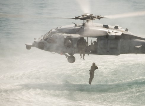 U.S. Navy explosive ordnance disposal (EOD) technicians assigned to Platoon 1-2-2, Explosive Ordnance Disposal Mobile Unit 1, Commander Task Group (CTG) 56.1, conduct cast, recovery and special purpose insertion and extraction training from an MH-60S Seahawk helicopter Aug. 11, 2014, in the Persian Gulf.  CTG-56.1 conducts mine countermeasures, EOD, salvage-diving, and force protection operations throughout the U.S. 5th Fleet area of responsibility. (DoD photo by Mass Communication Specialist 2nd Class Patrick Ratcliff, U.S. Navy/Released)
